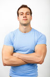 Bully or arrogance concept - muscular guy looking tough. Bully or arrogance concept - muscular young guy looking tough royalty free stock image