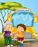 Bully boy picking on other boy in school bus Stock Photography