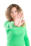 Bullying: Blonde woman making stop gesture Stock Photo