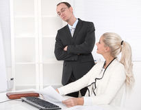 Bullying: boss controlling his secretary. Stock Photos