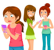 Bullying through cell phone. Girl being bullying by her peers through mobile  phone Royalty Free Stock Photo