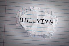 Bullying. Crumpled paper ball with word Bullying. Concept Image. Closeup stock photos