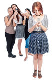 Bullying girls using smartphones Royalty Free Stock Images