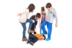 Bullying. Group of children bullying an isolated child royalty free stock image