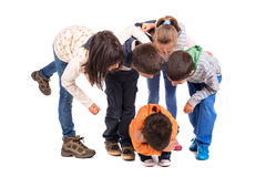 Bullying. Group of children bullying an isolated child Royalty Free Stock Images
