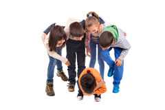 Bullying. Group of children bullying an isolated child Royalty Free Stock Photo