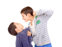 Bullying. Little boy bullying classmate isolated in white Stock Images
