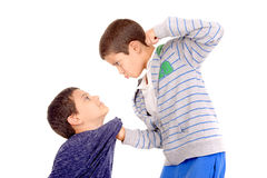 Bullying. Little boy bullying classmate isolated in white Royalty Free Stock Photography