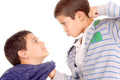 Bullying. Little boy bullying classmate isolated in white royalty free stock image