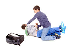 Bullying. Little boy bullying classmate isolated in white Royalty Free Stock Photo