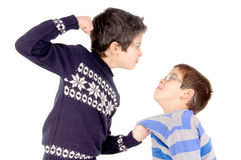 Bullying. Little boy bullying classmate isolated in white royalty free stock images