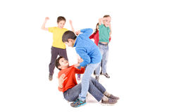 Bullying. Little kids bullying another kid isolated in white Stock Photos