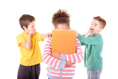 Bullying. Little kids bullying another kid isolated in white Royalty Free Stock Images