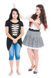 Bullying rabbit ears. Concept between girls on white background Royalty Free Stock Image