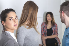 Bullying at school. White students bully an asian student Royalty Free Stock Images