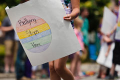 Bullying Stops Here. Taken in Des Moines, Iowa.  Protesters against bullying walk in the gay pride parade Royalty Free Stock Photography