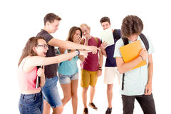 Bullying. Teenagers bullying another isolated in white Royalty Free Stock Photos