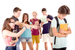 Bullying. Teenagers bullying another isolated in white stock images