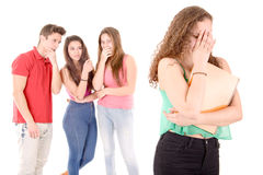 Bullying. Teenagers bullying a girl isolated in white background royalty free stock image