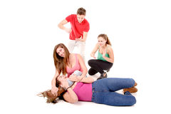 Bullying. Teenagers bullying a girl isolated in white background Stock Image