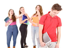 Bullying. Teenagers bullying a girl isolated in white background Royalty Free Stock Photo