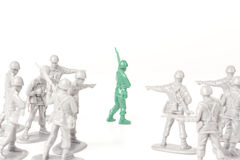 Bullying Toy Soldiers Royalty Free Stock Image