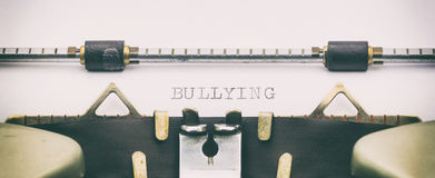 BULLYING word in capital letters on a typewriter sheet Royalty Free Stock Images