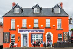 Bulman Bar & Toddies. Patrons enjoy each other`s company outside the renowned Bulman Bar in Kinsale, Ireland Royalty Free Stock Photography