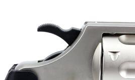 Bulta som är ner på revolver med vit bakgrund Arkivfoton