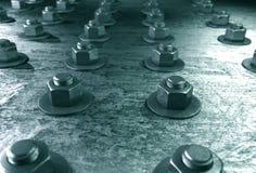 Bultar på stålplätering Arkivbild