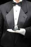 Bulter with Service Bell. Butlers holding service bell in gloved hand in front of body, torso only Stock Photos