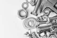 Bultmuttrar och tangent för trådda hållare Arkivfoto
