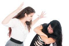 Bulying girl beeing aggressive with her friend Stock Photo