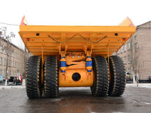 Bum. View from behind.Heavy tipper.Intended for transportation of ore mass in a career.A carrying capacity makes 220 tons.Through such machines a mountain breed Royalty Free Stock Image