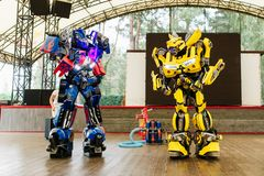 Bumblebee and optimus prime costumed actors for birthday party royalty free stock images