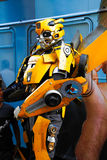 Bumblebee robot costume performs Royalty Free Stock Image