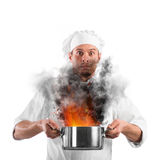 Bumbling chef. Chef shocked holding a pot with flames Royalty Free Stock Photo