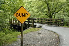 Bump ahead. A sign warning of a bump ahead in the road royalty free stock photography