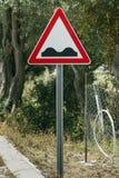 Bump ahead traffic sign in a Mediterranean environment. stock photos