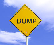 Bump in the Road. A sign signifying a bump on the road, many metaphorical uses Stock Image