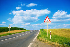 Bump sign by the road. Bump ahead sign by the road at summer royalty free stock images