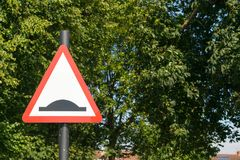 Bump warning traffic sign. In a park in GB Royalty Free Stock Image