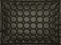 Bumped black leather background with circles. High resolution Royalty Free Stock Photo