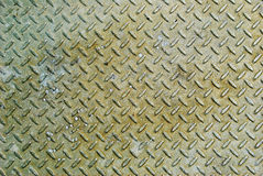 Bumped old metal texture background. Picture royalty free stock image