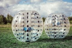 Bumper-balls for soccer playing on a green lawn royalty free stock image