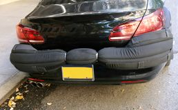 Bumper Blocker. Bumper guard was designed to protect your vehicle from the rear and the front. it shields your car in a public garage or outdoor parking. .It`s Stock Image