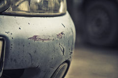 Bumper car scratched with deep damage to the paint. Royalty Free Stock Photo
