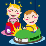 Bumper Cars. Boy and girl driving bumper cars having fun colliding Stock Image
