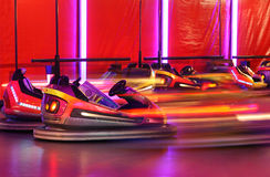 Bumper cars. In motion in amusement park Royalty Free Stock Photo