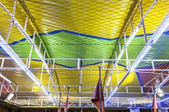 Bumper cars ceiling attraction. Metallic net detail Stock Photos